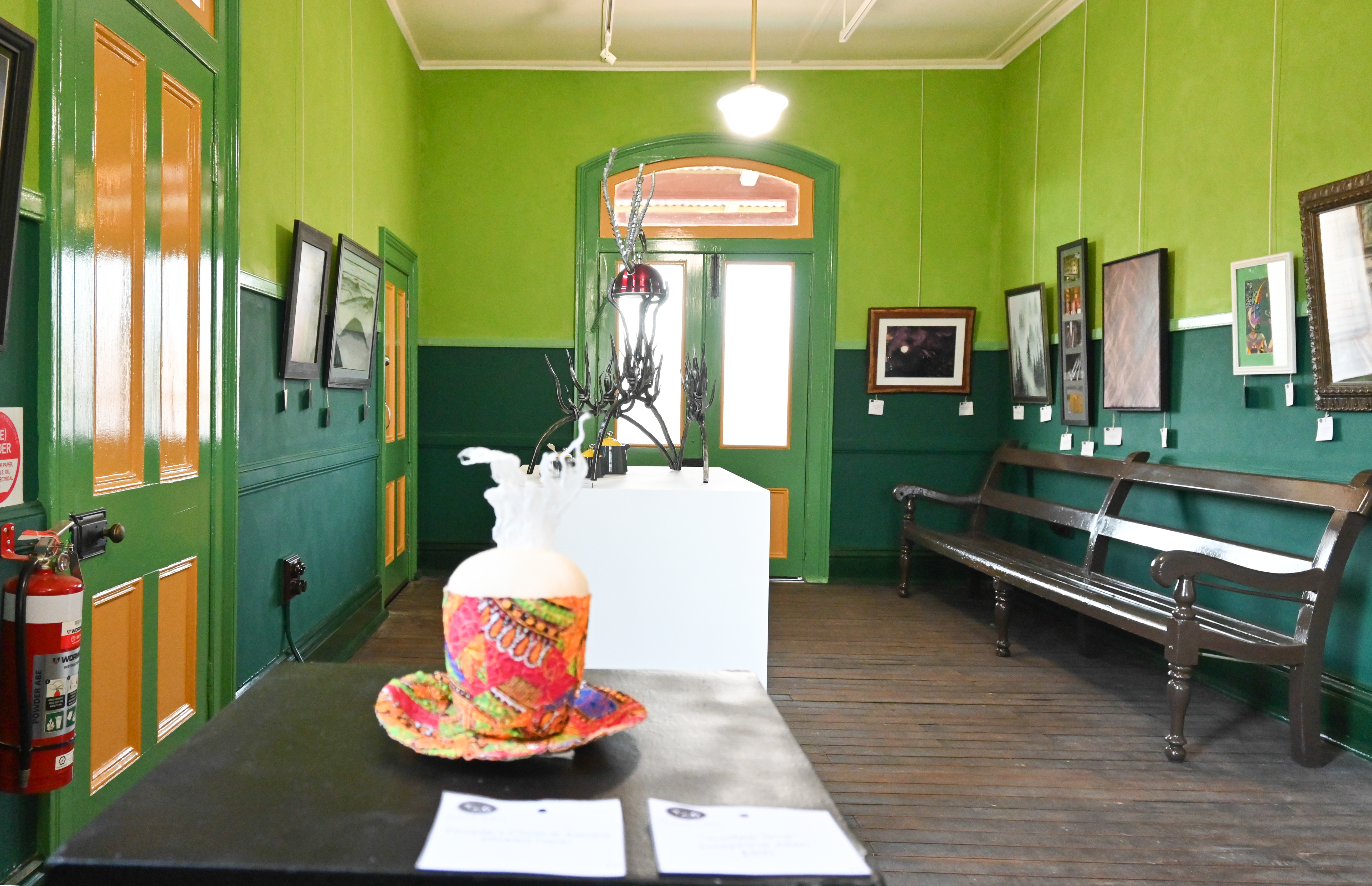 Inside the gallery with heritage coloured walls and artworks ion display. Photography of the launch of Textures of One on Blayney Station for Arts OutWest by Zenio Lapka.