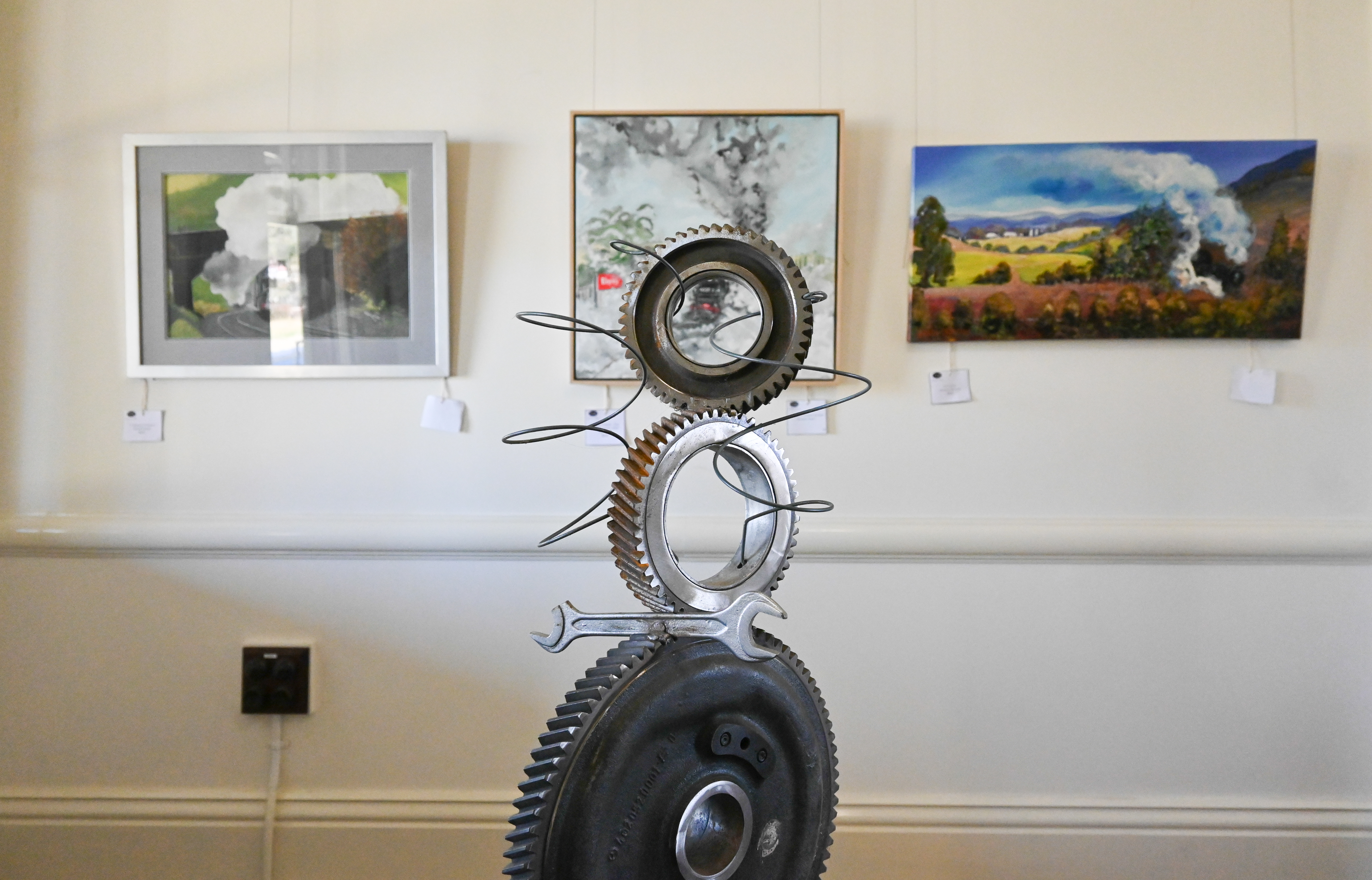 Inside the gallery with white painted walls and artworks ion display. Photography of the launch of Textures of One on Blayney Station for Arts OutWest by Zenio Lapka.
